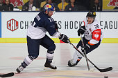 Keith Aucoin of EHC Red Bull Muenchen and Miroslav Macejko of HC Kosice during the Champions Hockey League group stage game between Red Bull Munich...