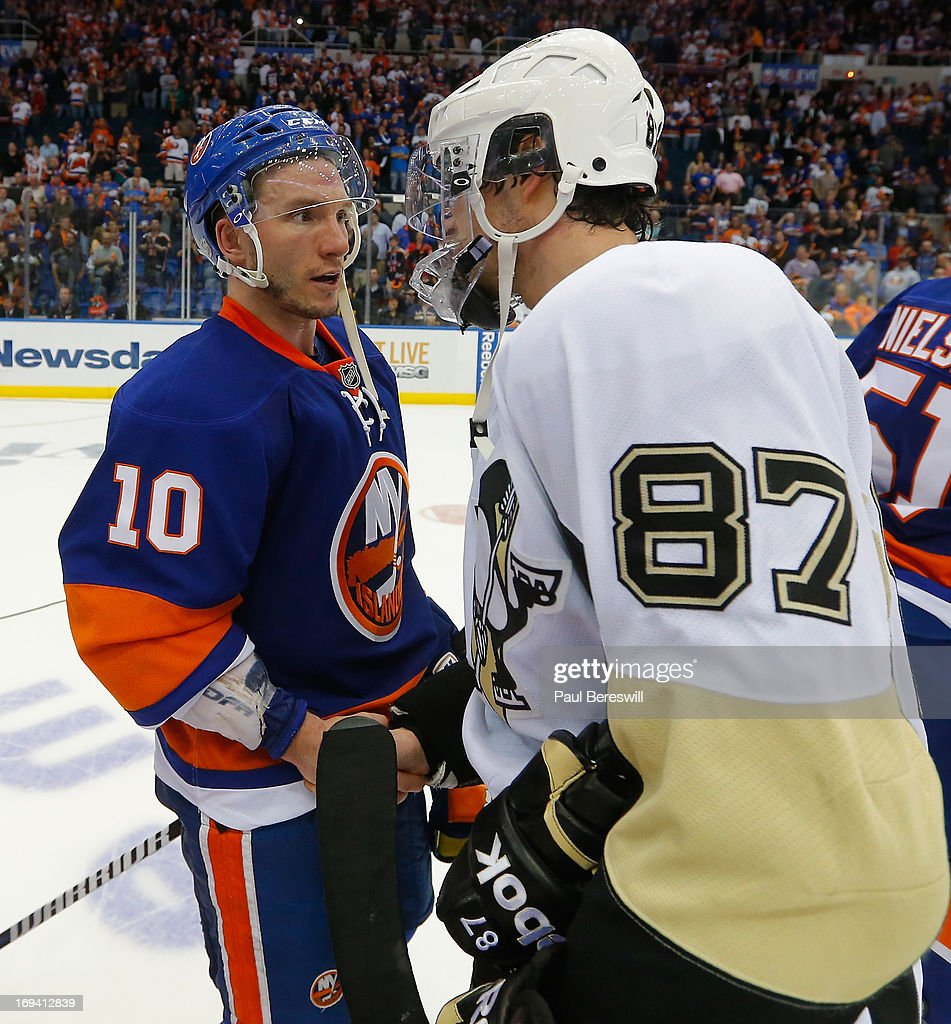 Keith Aucoin of the New York Islanders and Sidney Crosby of the Pittsburgh Penguins greet on the ice after the Islanders were defeated and eliminated...
