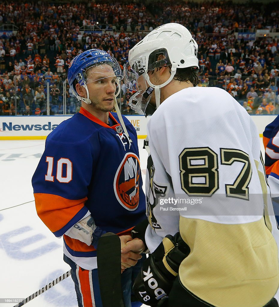 Keith Aucoin #10 of the New York Islanders and Sidney Crosby #87 of the Pittsburgh Penguins greet on the ice after the Islanders were defeated and eliminated from the playoffs by the Penguins in Game Six of the Eastern Conference Quarterfinals during the 2013 NHL Stanley Cup Playoffs at Nassau Veterans Memorial Coliseum on May 11, 2013 in Uniondale, New York.
