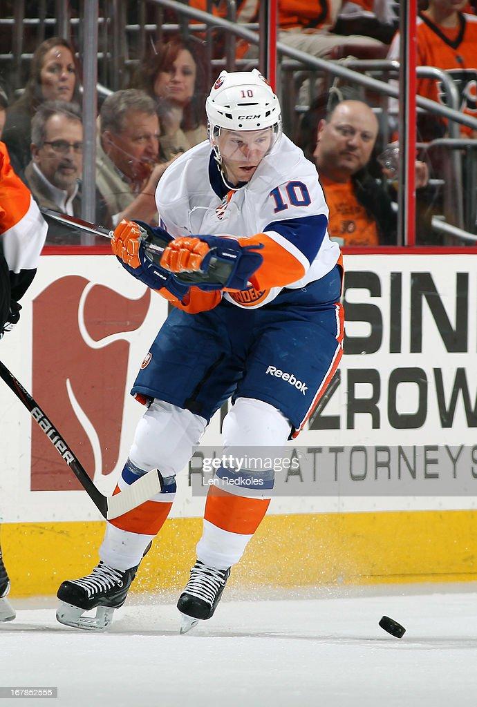 Keith Aucoin #10 of the New York Islanders battles for the puck against the Philadelphia Flyers on April 25, 2013 at the Wells Fargo Center in Philadelphia, Pennsylvania.
