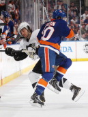 Keith Aucoin of the New York Islanders collides with Kris Letang of the Pittsburgh Penguins in Game Four of the Eastern Conference Quarterfinals...
