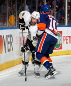 Keith Aucoin of the New York Islanders covers Pascal Dupuis of the Pittsburgh Penguins in Game Six of the Eastern Conference Quarterfinals during the...