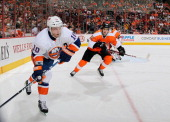 Keith Aucoin of the New York Islanders in action against Brandon Manning and Ilya Bryzgalov of the Philadelphia Flyers on April 25 2013 at the Wells...
