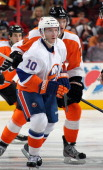 Keith Aucoin of the New York Islanders in action against Sean Couturier of the Philadelphia Flyers on April 25 2013 at the Wells Fargo Center in...