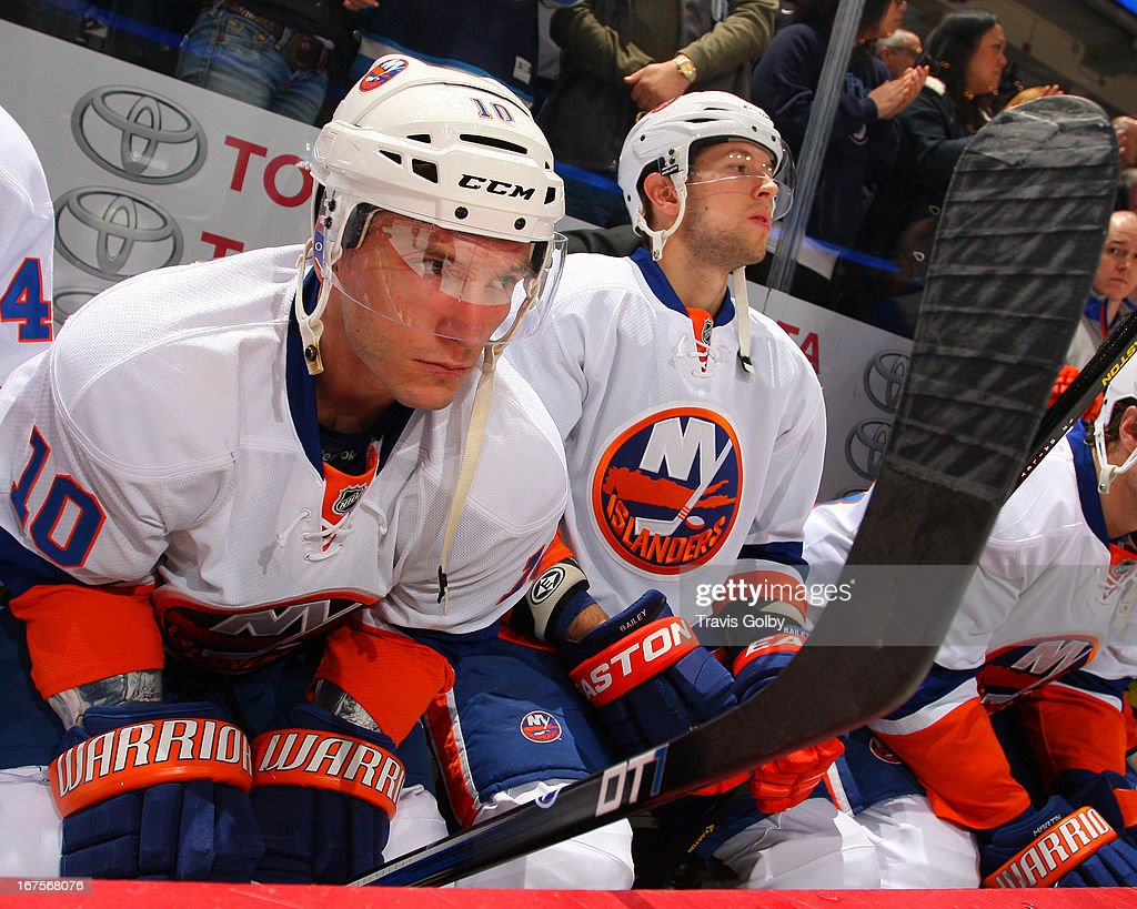 Keith Aucoin of the New York Islanders looks on from the bench prior to puck drop against the Winnipeg Jets at the MTS Centre on April 20 2013 in...