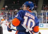 Keith Aucoin of the New York Islanders skates against the Carolina Hurricanes at Nassau Veterans Memorial Coliseum on February 11 2013 in Uniondale...