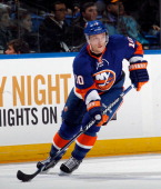 Keith Aucoin of the New York Islanders skates against the Montreal Canadiens at the Nassau Veterans Memorial Coliseum on March 21 2013 in Uniondale...