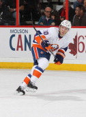 Keith Aucoin of the New York Islanders skates against the Ottawa Senators on February 19 2013 at Scotiabank Place in Ottawa Ontario Canada