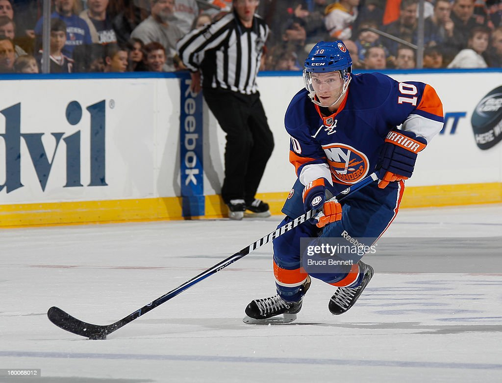 Keith Aucoin of the New York Islanders skates against the Tampa Bay Lightning at the Nassau Veterans Memorial Coliseum on January 21 2013 in...