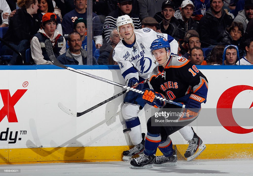 <a gi-track='captionPersonalityLinkClicked' href=/galleries/search?phrase=Keith+Aucoin&family=editorial&specificpeople=2125652 ng-click='$event.stopPropagation()'>Keith Aucoin</a> #10 of the New York Islanders skates against the Tampa Bay Lightning at the Nassau Veterans Memorial Coliseum on April 6, 2013 in Uniondale, New York. The Islanders defeated the Lightning 4-2.