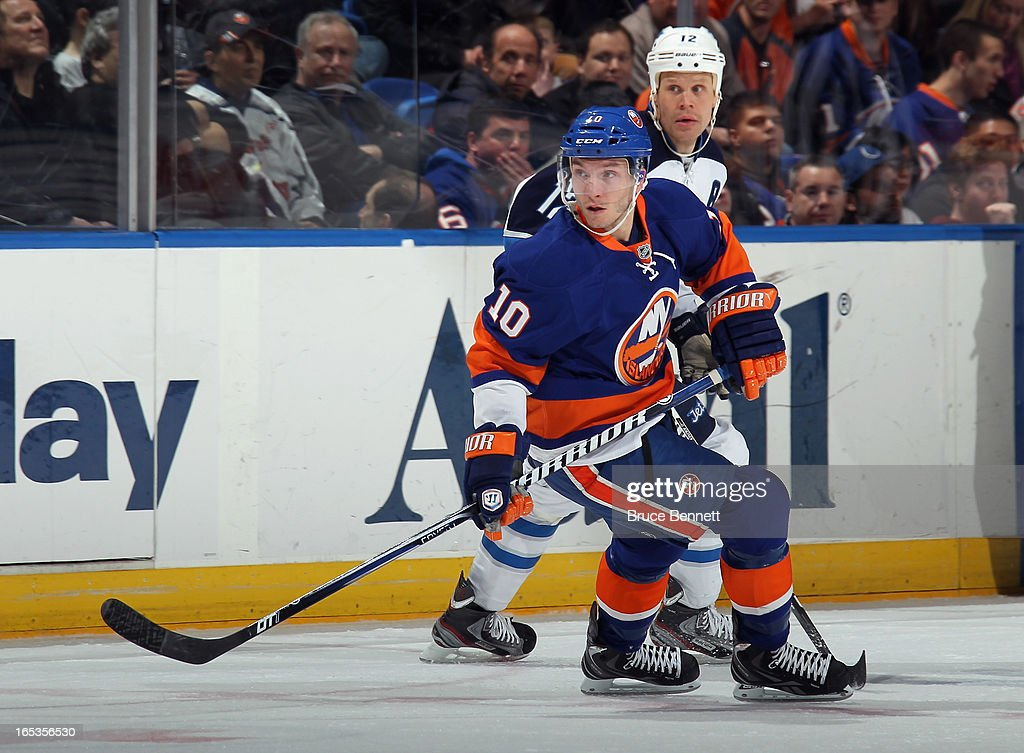 Keith Aucoin of the New York Islanders skates against the Winnipeg Jets at the Nassau Veterans Memorial Coliseum on April 2 2013 in Uniondale New...