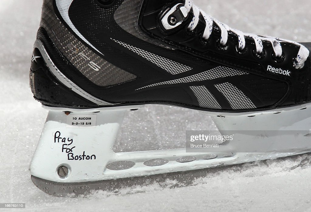 Keith Aucoin #10 of the New York Islanders skates in warmups prior to playing against the Florida Panthers with skates bearing the words 'Pray for Boston' at the Nassau Veterans Memorial Coliseum on April 16, 2013 in Uniondale, New York.
