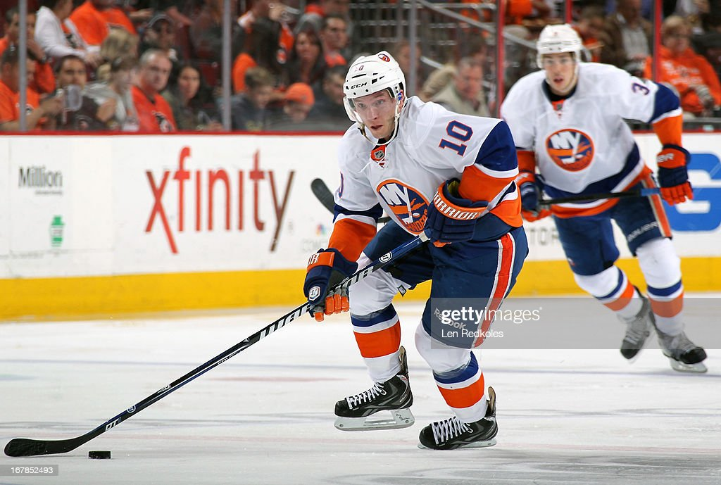 Keith Aucoin of the New York Islanders skates the puck against the Philadelphia Flyers on April 25 2013 at the Wells Fargo Center in Philadelphia...