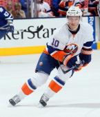 Keith Aucoin of the New York Islanders skates up the ice during NHL action against the Toronto Maple Leafs at the Air Canada Centre January 24 2013...
