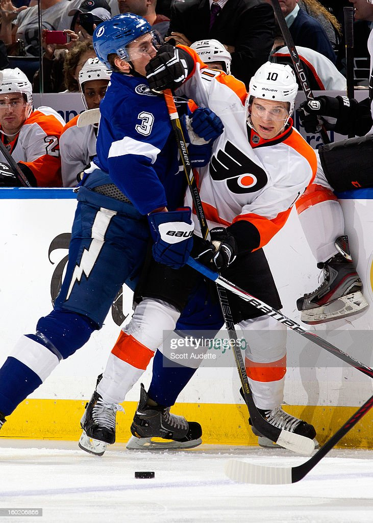 Keith Aulie #3 of the Tampa Bay Lightning and <a gi-track='captionPersonalityLinkClicked' href=/galleries/search?phrase=Brayden+Schenn&family=editorial&specificpeople=4782304 ng-click='$event.stopPropagation()'>Brayden Schenn</a> #10 of the Philadelphia Flyers battle for the puck during the first period of an NHL game at the Tampa Bay Times Forum on January 27, 2013 in Tampa, Florida.