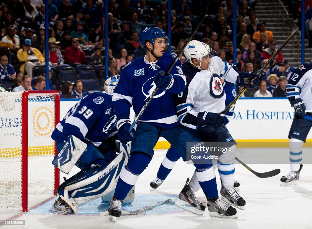 Keith Aulie #3 of the Tampa Bay Lightning and <a gi-track='captionPersonalityLinkClicked' href=/galleries/search?phrase=Evander+Kane&family=editorial&specificpeople=4303789 ng-click='$event.stopPropagation()'>Evander Kane</a> #9 of the Winnipeg Jets react to a play during the second period of the game at the Tampa Bay Times Forum on March 7, 2013 in Tampa, Florida.