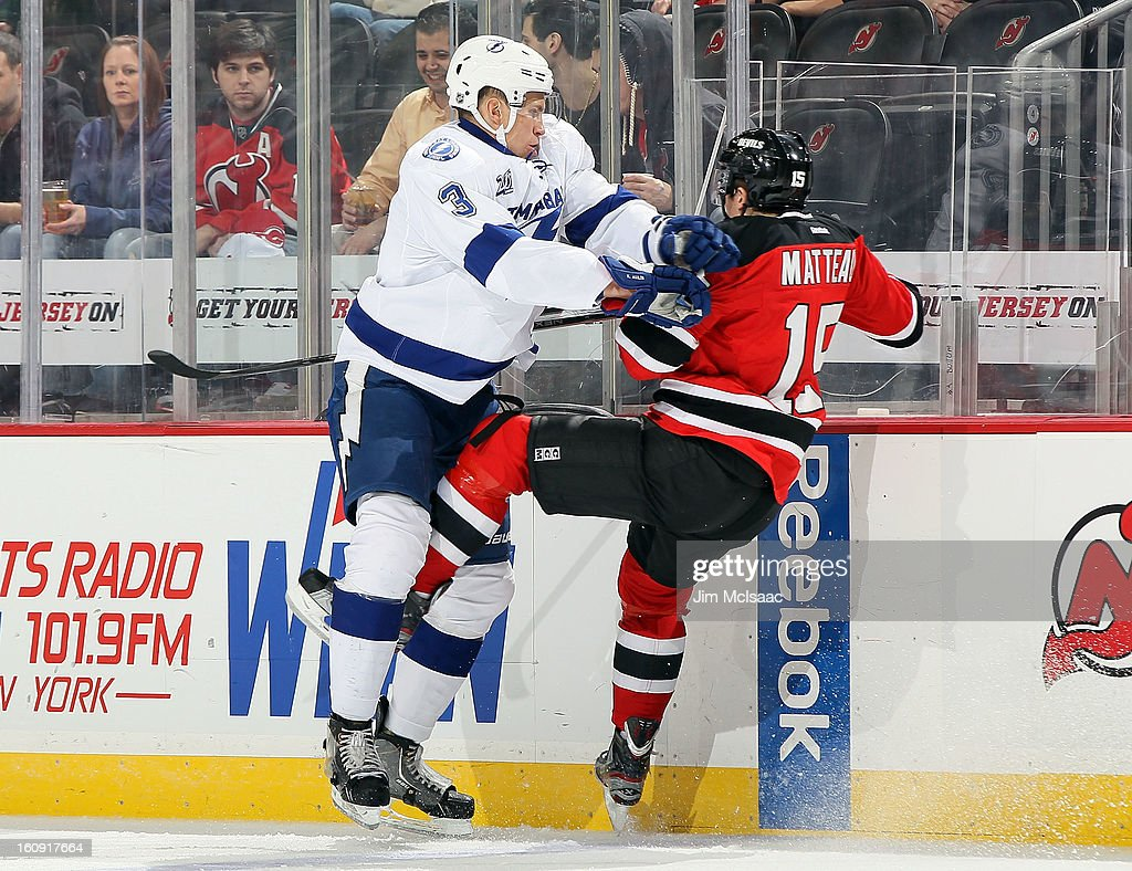 Keith Aulie #3 of the Tampa Bay Lightning checks <a gi-track='captionPersonalityLinkClicked' href=/galleries/search?phrase=Stefan+Matteau&family=editorial&specificpeople=9480769 ng-click='$event.stopPropagation()'>Stefan Matteau</a> #15 of the New Jersey Devils at the Prudential Center on February 7, 2013 in Newark, New Jersey.