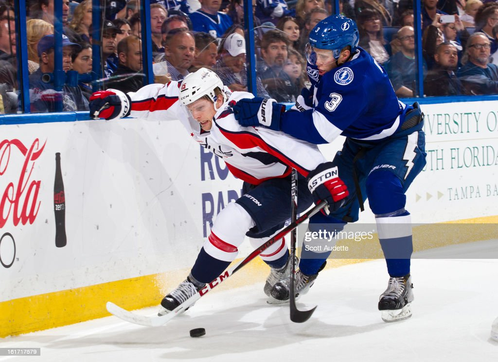 Keith Aulie #3 of the Tampa Bay Lightning fights for control of the puck with Joey Crabb #15 of the Washington Capitals during the second period of the game at the Tampa Bay Times Forum on February 14, 2013 in Tampa, Florida.