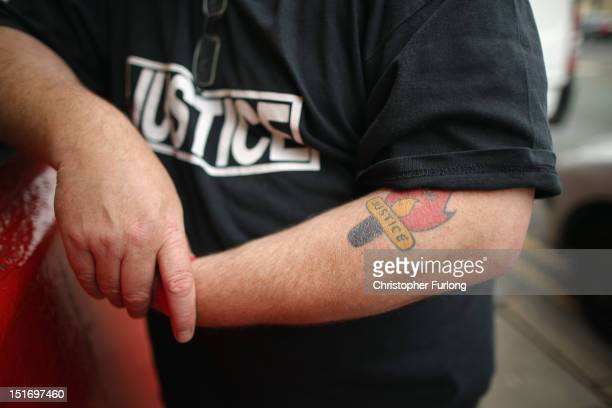 Keith Baldwin of the Hillsborough Justice Campaign shows his 'Justice' tattoo outside the campaign headquarters near Anfield Stadium home of...