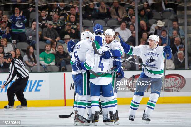 Keith Ballard Jason Garrison Zack Kassian and Ryan Kesler of the Vancouver Canucks celebrate a win against the Dallas Stars at the American Airlines...
