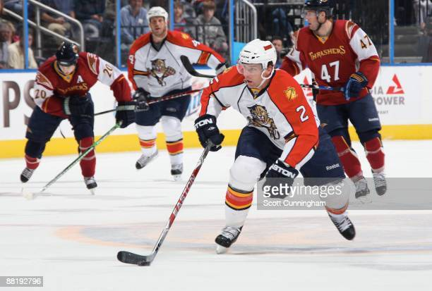 Keith Ballard of the Florida Panthers carries the puck against the Atlanta Thrashers at Philips Arena on April 9 2009 in Atlanta Georgia