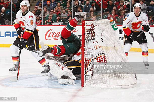 Keith Ballard of the Minnesota Wild is called for a goalie interference penalty against Reto Berra of the Calgary Flames during the game on March 3...