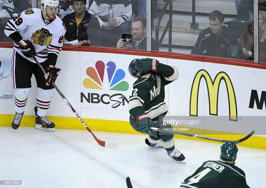 Keith Ballard #2 of the Minnesota Wild reacts to being hit in the face by the stick of Bryan Bickell #29 of the Chicago Blackhawks during the third period in Game Six of the Second Round of the 2014 NHL Stanley Cup Playoffs on May 13, 2014 at Xcel Energy Center in St Paul, Minnesota. The Blackhawks defeated the Wild 2-1 in overtime.