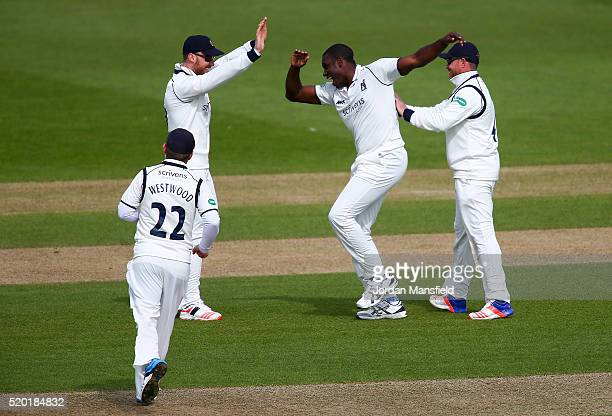 Keith Barker of Warwickshire celebrates with his teammates after getting the wicket of Tom Alsop of Hampshire during day one of the Specsavers County...