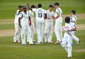 Keith Barker of Warwickshire celebrates with his teammates after getting the wicket of Sean Ervine of Hampshire as he walks off during day four of...