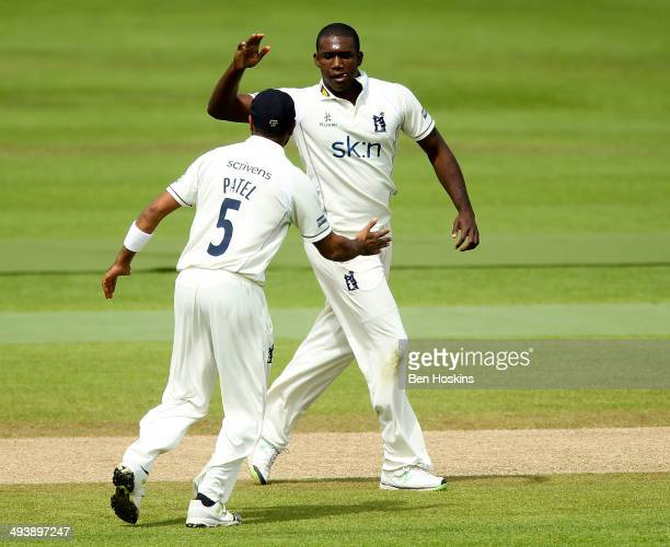Keith Barker of Warwickshire celebrates with team mate Jeetan Patel after dismissing James Hildreth of Somerset during the LV County Championship...