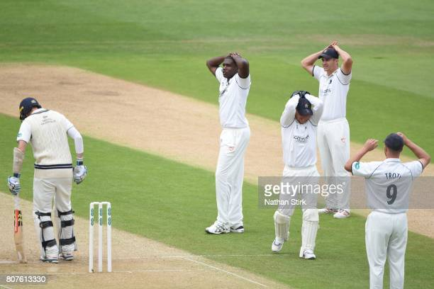 Keith Barker Tim Ambrose and Sam Hain of Warwickshire look on during the Specsavers County Championship Division One match between Warwickshire and...