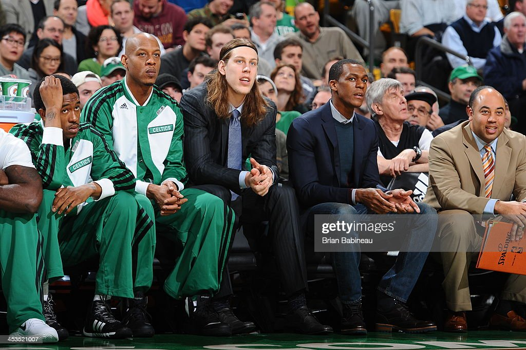Keith Bogans #4, Kelly Olynyk #41 and Rajon Rondo #9 of the Boston Celtics look on during the game against the Milwaukee Bucks on December 3, 2013 at the TD Garden in Boston, Massachusetts.