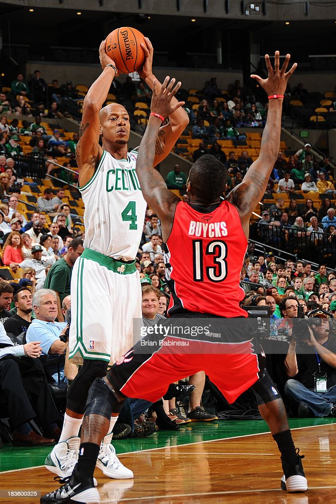 Keith Bogans #4 of the Boston Celtics tries to pass the ball against Dwight Buycks #13 of the Toronto Raptors on October 7, 2013 at the TD Garden in Boston, Massachusetts.