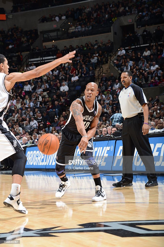 Keith Bogans #10 of the Brooklyn Nets dishes the ball down low against the San Antonio Spurs on December 31, 2012 at the AT&T Center in San Antonio, Texas.
