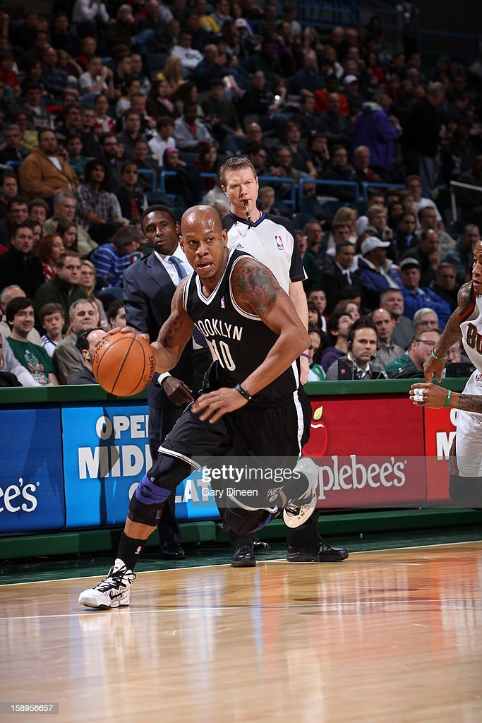 <a gi-track='captionPersonalityLinkClicked' href=/galleries/search?phrase=Keith+Bogans&family=editorial&specificpeople=202483 ng-click='$event.stopPropagation()'>Keith Bogans</a> #10 of the Brooklyn Nets drives to the basket against the Milwaukee Bucks on December 26, 2012 at the BMO Harris Bradley Center in Milwaukee, Wisconsin.