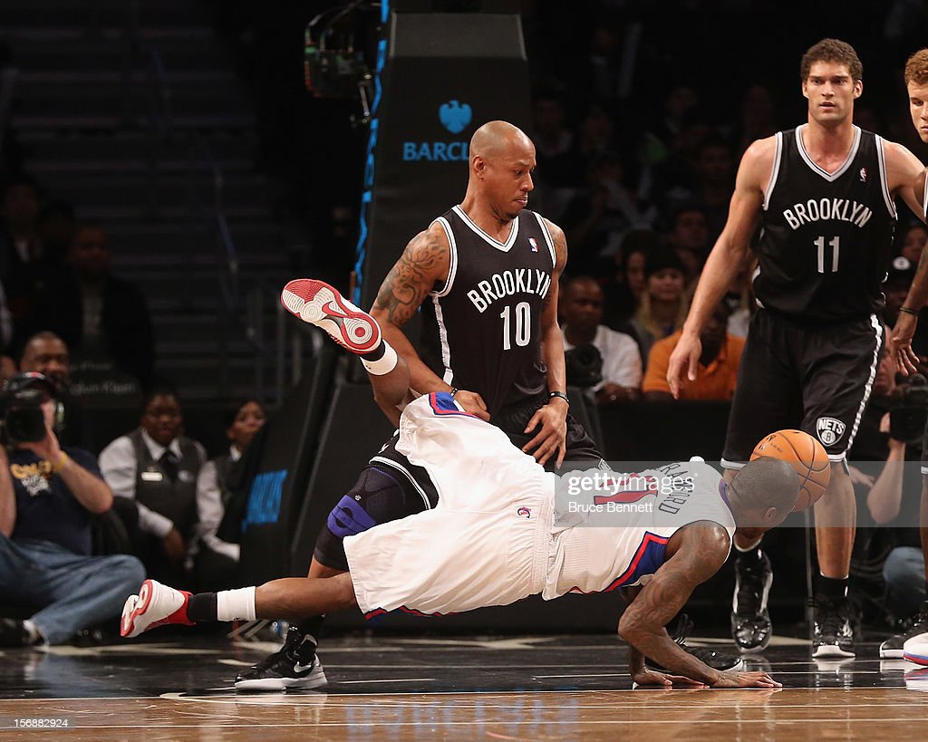 Keith Bogans #10 of the Brooklyn Nets fouls Jamal Crawford #11 of the Los Angeles Clippers in the fourth quarter at the Barclays Center on November 23, 2012 in the Brooklyn borough of New York City.