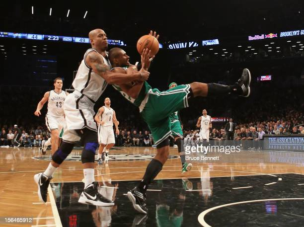 Keith Bogans of the Brooklyn Nets fouls Leandro Barbosa of the Boston Celtics in the second quarter at the Barclays Center on November 15 2012 in the...