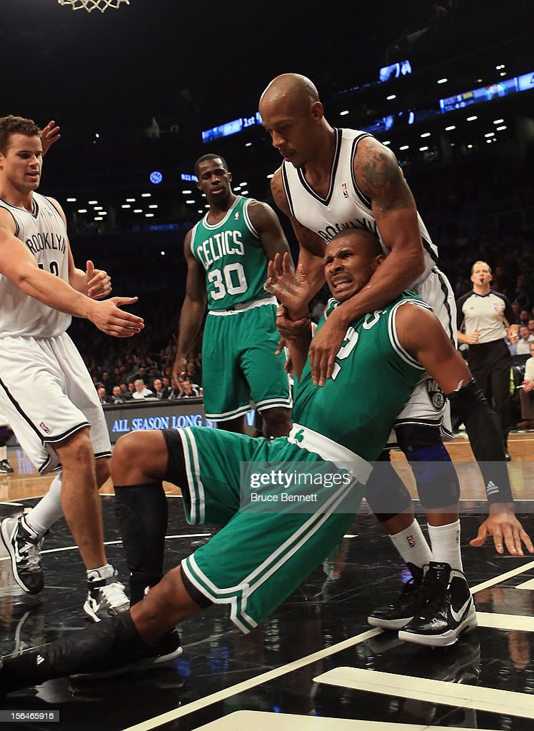 <a gi-track='captionPersonalityLinkClicked' href=/galleries/search?phrase=Keith+Bogans&family=editorial&specificpeople=202483 ng-click='$event.stopPropagation()'>Keith Bogans</a> #10 of the Brooklyn Nets fouls <a gi-track='captionPersonalityLinkClicked' href=/galleries/search?phrase=Leandro+Barbosa&family=editorial&specificpeople=201506 ng-click='$event.stopPropagation()'>Leandro Barbosa</a> #12 of the Boston Celtics in the second quarter at the Barclays Center on November 15, 2012 in the Brooklyn borough of New York City.
