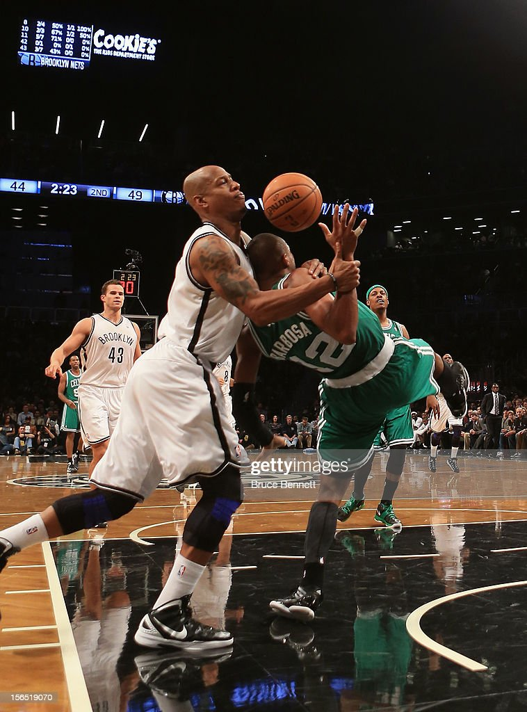 Keith Bogans #10 of the Brooklyn Nets fouls Leandro Barbosa #12 of the Boston Celtics in the second quarter at the Barclays Center on November 15, 2012 in the Brooklyn borough of New York City.