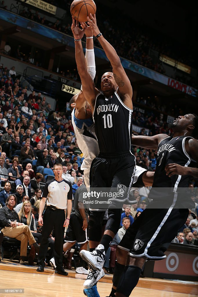 Keith Bogans #10 of the Brooklyn Nets grabs a rebound against the Minnesota Timberwolves on January 23, 2013 at Target Center in Minneapolis, Minnesota.