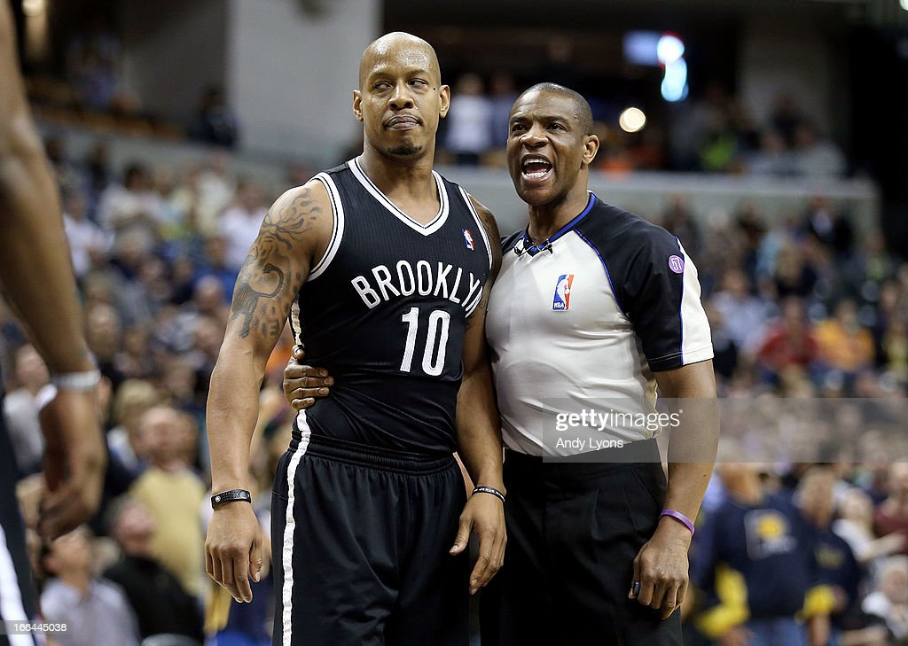 <a gi-track='captionPersonalityLinkClicked' href=/galleries/search?phrase=Keith+Bogans&family=editorial&specificpeople=202483 ng-click='$event.stopPropagation()'>Keith Bogans</a> #10 of the Brooklyn Nets is restrained by a game offical during an altercation in the game against the Indiana Pacers at Bankers Life Fieldhouse on April 12, 2013 in Indianapolis, Indiana.