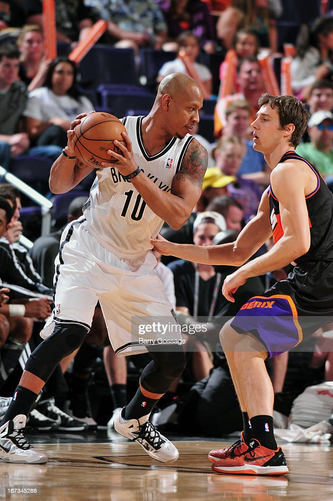 <a gi-track='captionPersonalityLinkClicked' href=/galleries/search?phrase=Keith+Bogans&family=editorial&specificpeople=202483 ng-click='$event.stopPropagation()'>Keith Bogans</a> #10 of the Brooklyn Nets looks to pass the ball against the Phoenix Suns on March 24, 2013 at U.S. Airways Center in Phoenix, Arizona.