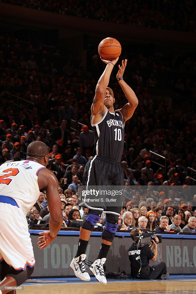 <a gi-track='captionPersonalityLinkClicked' href=/galleries/search?phrase=Keith+Bogans&family=editorial&specificpeople=202483 ng-click='$event.stopPropagation()'>Keith Bogans</a> #10 of the Brooklyn Nets shoots against the New York Knicks on December 19, 2012 at Madison Square Garden in New York City.