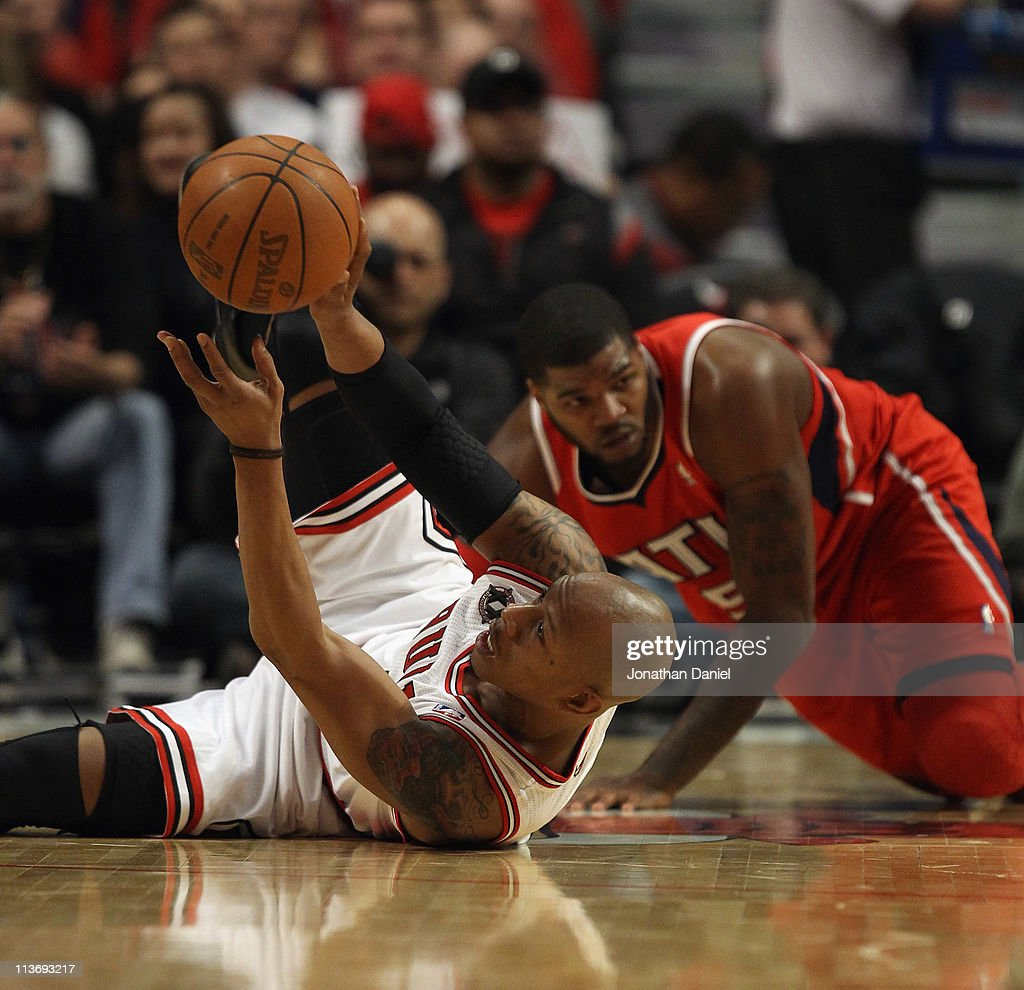 <a gi-track='captionPersonalityLinkClicked' href=/galleries/search?phrase=Keith+Bogans&family=editorial&specificpeople=202483 ng-click='$event.stopPropagation()'>Keith Bogans</a> #6 of the Chicago Bulls recovers the ball after colliding with <a gi-track='captionPersonalityLinkClicked' href=/galleries/search?phrase=Josh+Smith+-+Basketball+Player+-+Born+1985&family=editorial&specificpeople=201983 ng-click='$event.stopPropagation()'>Josh Smith</a> #5 of the Atlanta Hawks in Game Two of the Eastern Conference Semifinals in the 2011 NBA Playoffs at the United Center on May 4, 2011 in Chicago, Illinois. The Bulls defeated the Hawks 86-73.