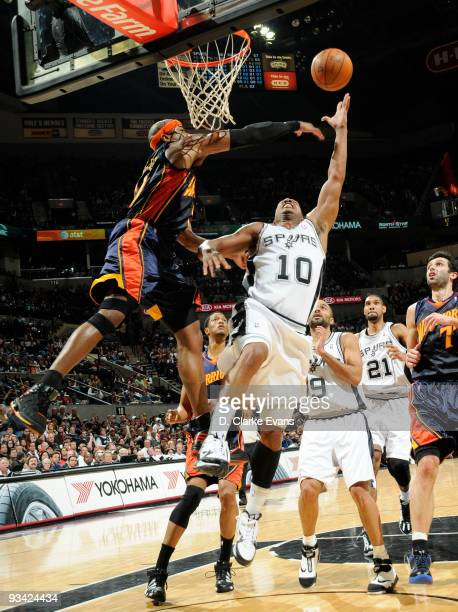 Keith Bogans of the San Antonio Spurs shoots against Corey Maggette of the Golden State Warriors on November 25 2009 at the ATT Center in San Antonio...