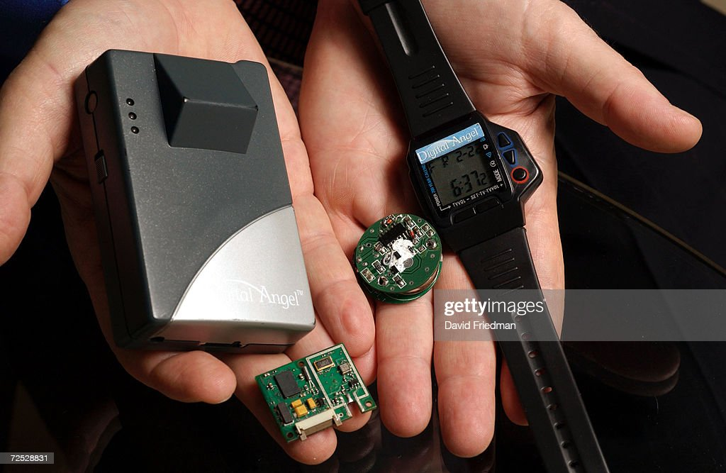 Keith Bolton chief technology officer of Applied Digital Solutions demonstrates pager and watch versions of the companys Digital Angel product which...