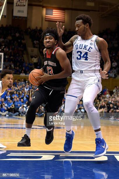 Keith Braxton of the St Francis Red Flash drives against Wendell Carter Jr #34 of the Duke Blue Devils at Cameron Indoor Stadium on December 5 2017...