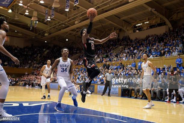 Keith Braxton of the St Francis Red Flash goes to the basket against the Duke Blue Devils at Cameron Indoor Stadium on December 5 2017 in Durham...