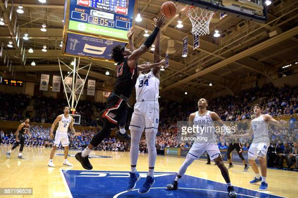Keith Braxton of the St Francis Red Flash puts up a shot against Wendell Carter Jr #34 of the Duke Blue Devils at Cameron Indoor Stadium on December...