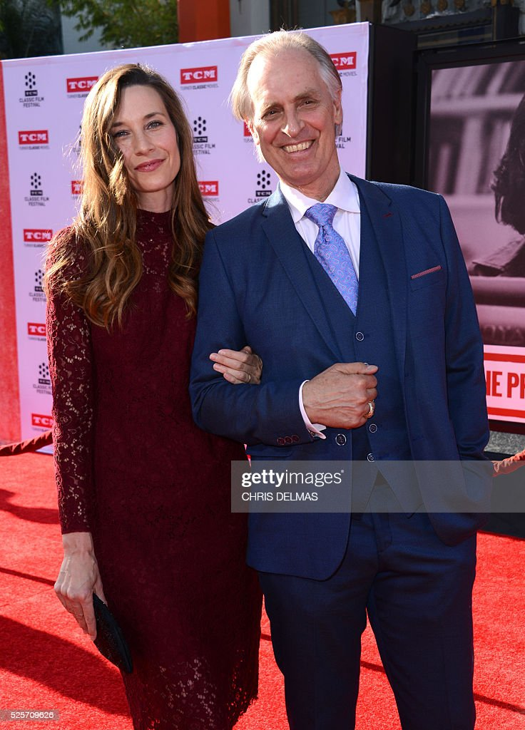 Keith Carradine and his wife attend the Opening Night Gala of the 2016 TCM Classic Film Festival celebrating The 40th Anniversary Screening of ALL THE PRESIDENT��S MEN at the Chines Theatre in Hollywood, California, on April 28, 2016. / AFP / CHRIS